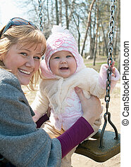 smiling women with beautiful baby