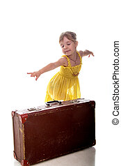 The young traveler girl with a suitcase. Isolated over white background