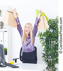 the young woman at office with beautiful bags