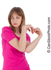The young woman holds hands in the form of heart