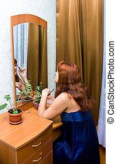 woman in a dark blue peignoir