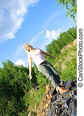 woman on a stony hill