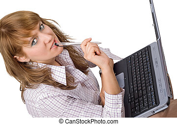 The young woman sits with the laptop. Isolated