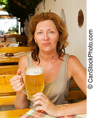 The young woman with a beer mug