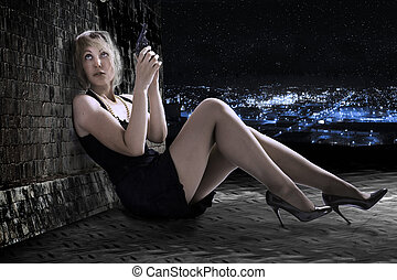 The young woman with the gun on a roof. Night.