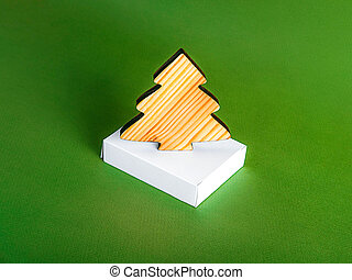 The zero waste new year concept as a wooden fir tree on the green background.