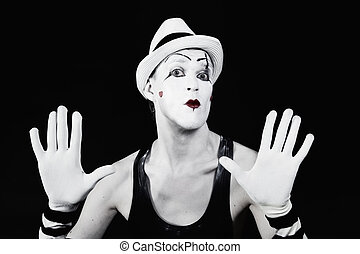 Theater actor in makeup mime clown