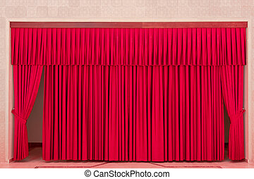 Theater interior with red curtains