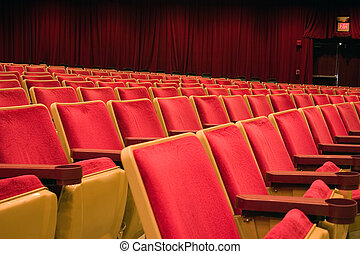 Theater seating - rows of seats in a theater making a great...