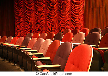 Row of seats in an empty theater