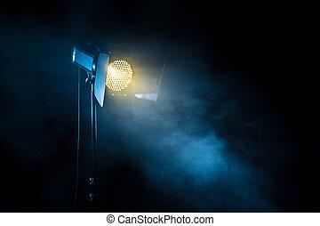 Theater spot light on black background.