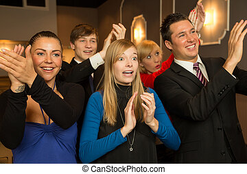 Audience in a theatre, on a concert or in a cinema clapping and applauding