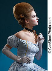 Theatre. Fairy Tale. Fancy woman in a blue dress - Retro Hairstyle. Medieval Fantasy.