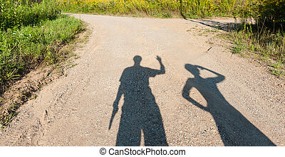 Theatre of shadows boy and girl on rural path