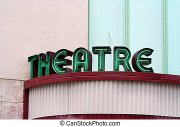 Theatre Sign - Green theatre sign on pink building