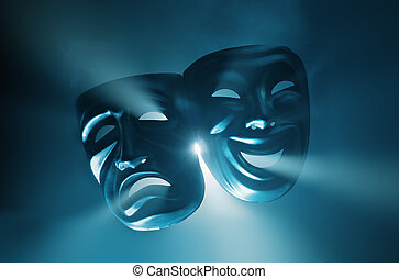 Theatre - Crying and smiling masks in hazy light.