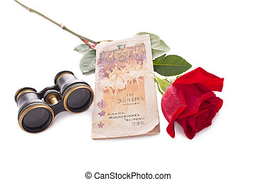 Theatre tickets and red rose isolated on white.