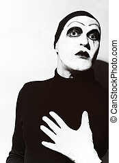 Theatrical actor with dark mime makeup - Theatrical actor...