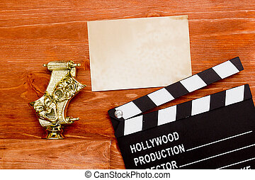 Theatrical masks and movie clapper