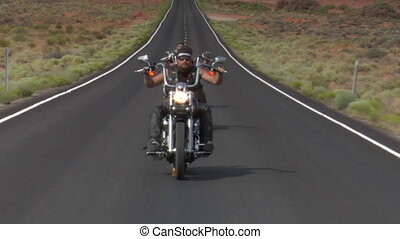 Thee motorcycles speed on desert highway