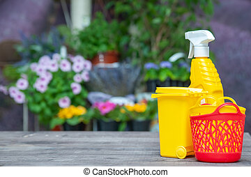Theme cleaning products at home, cleaning products on the background of a flower bed