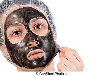 Girl with peel-off mask