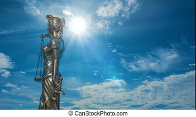 Themis against the backdrop of a beautiful cloud timelapse,...