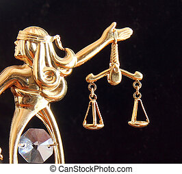 Themis statue and handcuffs over dark background