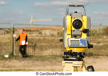surveyor workers with theodolite equipment device outdoors