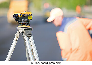 Theodolite tool at construction site during road works