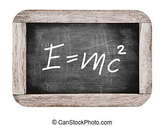 Theory of relativity by Albert Einsteins on blackboard