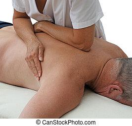 Therapist applying pressure - Female sport massage therapist...