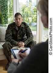 Therapist diagnosing soldier
