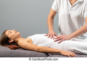 Therapist Doing Abdomen Massage On Little Girl