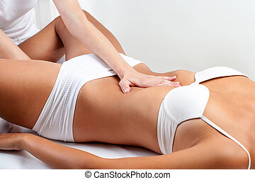 Therapist doing abdominal massage on woman. - Close up of...