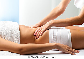 Therapist doing curative belly massage on female patient. -...