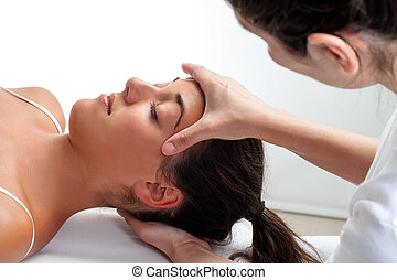 Therapist doing healing treatment on womans head. - Close up...
