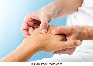 Therapist doing massage on female hand. - Macro close up of...