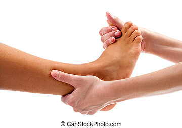 Therapist doing osteopathic reflexology massage