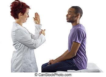 Therapist fixing posture