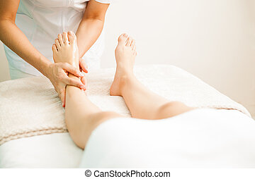 Therapist giving a foot massage