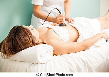 Therapist giving a reductive massage