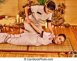 Therapist giving massage to woman. - Therapist giving...