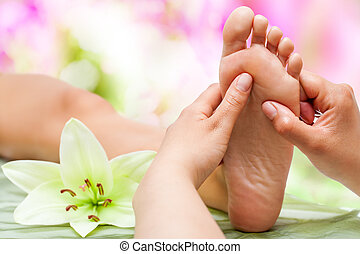 Therapist hands massaging foot. - Close up of therapist's ...