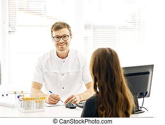 therapist is looking at the camera while talking with a female client