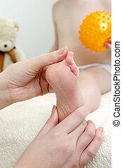 Therapist makes a child massage. Close-up