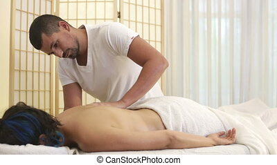 Therapist massage session - Shot of Therapist massage...