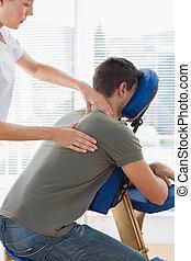 Therapist massaging in hospital - Therapist massaging man on...