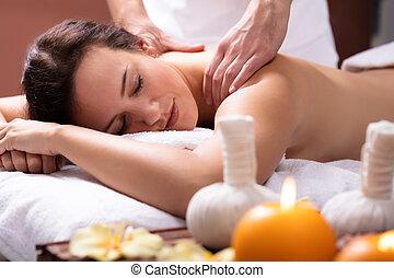 Therapist Massaging Woman's Back