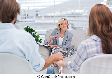 Therapist talking to a couple